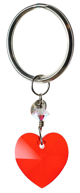 Swarovski key chain made with silver and a beautiful red heart shaped crystal.