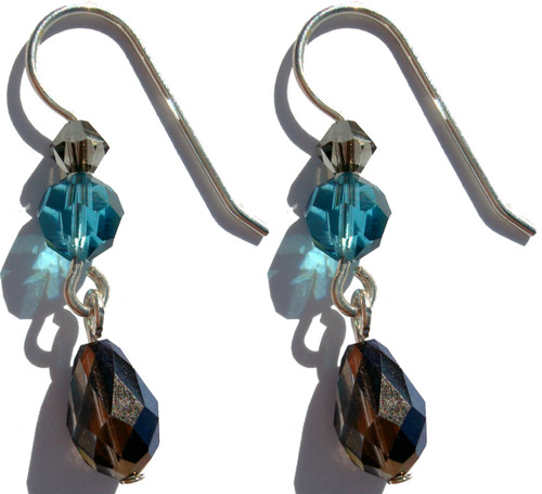 Limited edition designer earrings, handcrafted on sterling silver, exclusively made with Swarovski® crystal   Colors include:  Smokey Topez, bermuda blue and Indicolite.
