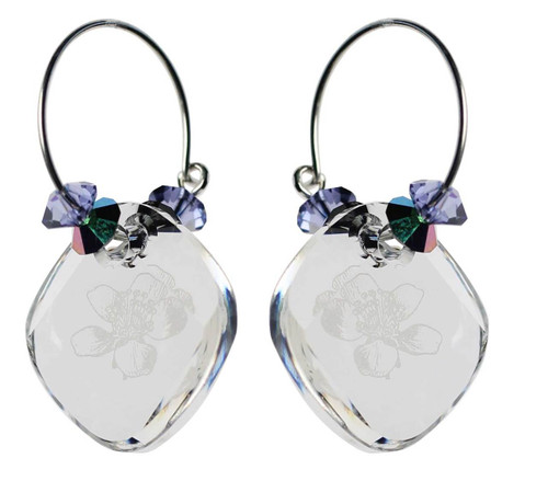 Clear crystal sterling silver hoop earrings with orchid flower etched in center Swarovski crystal.
