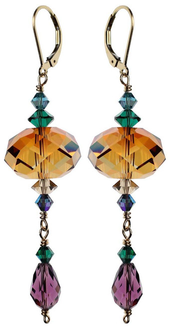 Shoulder duster crystal earrings made with large orange amber beads.