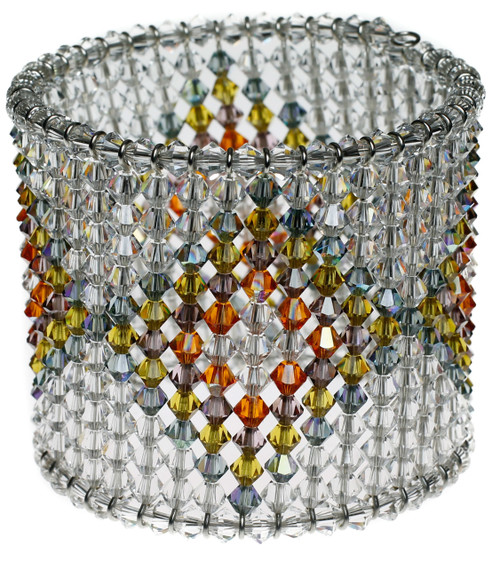 Patterned cuff bracelet with layered diamond pattern in jewel tones.