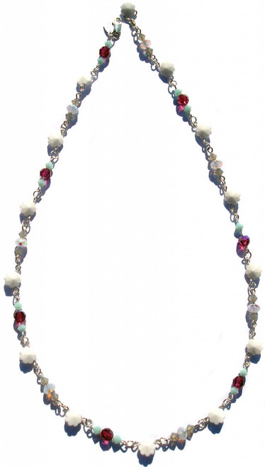 Simple and elegant single strand Swarovski elements necklace.  Created on sterling silver. Flower shaped white crystals are from the 1930's. Other colors include turquoise, fushcia, and sand.