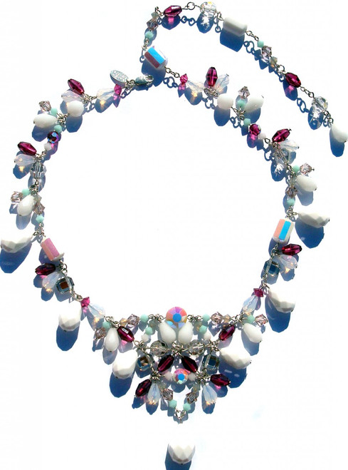 Hand made Swarovski crystal necklace on sterling silver. Titled the chunky v-necklace and made with larger size Swarovski elements. It can adjust to different lengths and incorporates very rare beads that date back to the turn of the century.