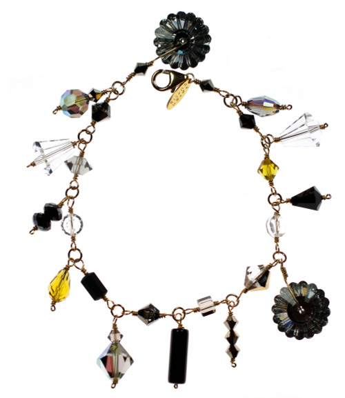 Swarovski crystal charm bracelet with rare and vintage elements. Hand made in NYC by Karen Curtis.