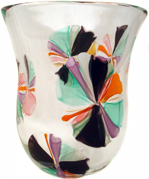 hand blown vase made with colored cane,  flower bursts flow throughout this clear based vase emphasizing the depth in the design