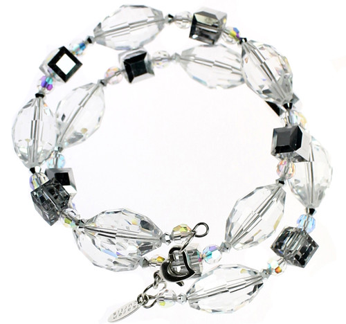Hand crafted Bangle Bracelet made with Swarovski® Elements.  Limited edition with clear and silver crystals