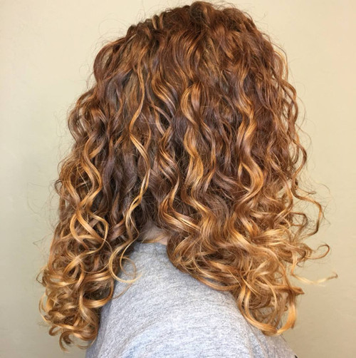 Create a beautiful, strong curly haircut which will help enhance and tame your curls.