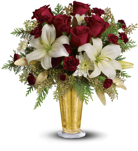 A classic beauty. Red roses and white asiatic lilies are arranged in a festive gold colored vase.  Actual vase may vary from picture.