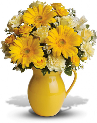 This bouquet is just bright for any occasion! A bright and sunny medley of flowers is hand-delivered in a brilliant ceramic pitcher that can be joyfully used over and over again.