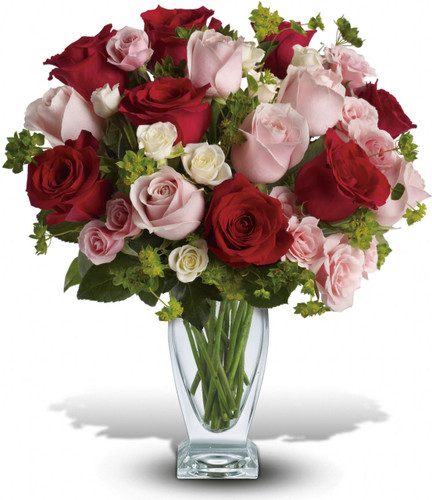 Classic beauty and romance to spare, thanks to the graceful lines of a Couture Vase filled with stunning roses - the iconic flower of love. Like the arrow released from Cupid's bow, this gorgeous bouquet will go straight to your lover's heart.