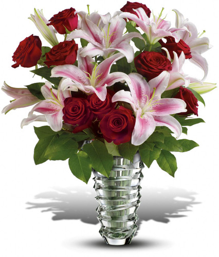 Pull out all the stops and surprise your Valentine with 10 red roses and four stems of pink oriental lilies in a contemporary vase. Sure, it's a little extravagant - she's worth it! Think of it as love insurance.  Actual vase may vary but will be a High End Vase.