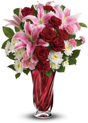 Show her the many colors of your love with this spectacular arrangement of romantic flowers. Hand-delivered in a stunning, limited-edition art glass vase, this bouquet of fragrant pink lilies, rich red roses and snow white chrysanthemums is truly a recipe for pure romance!  Vase may differ but will be a high end keepsake vase.