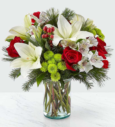 Whether you're sending season greeting's from across the country or welcoming guest to your home, our Christmas Spirit Bouquet shares every message of warmth and cheer. Filled with a collection of white lilies, red roses, red hypericum berries and white alstroemeria, this arrangement helps make every occasion beautiful. Give this to your loved ones, or as a gift to yourself to deck the halls during the holidays.