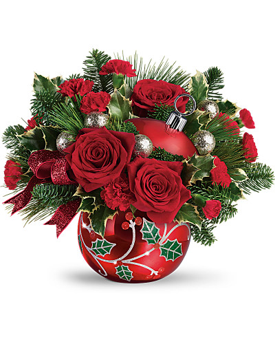 Jolly holly! Festive as can be, this shimmering ceramic ornament jar is hand-glazed and hand-finished with whimsical holly details. Beautiful bursting with Christmas roses or serving holiday treats! This festive bouquet includes red roses, red miniature carnations, variegated holly, noble fir, and white pine. Delivered in Teleflora's Deck the Holly Ornament or similar. Orientation: All-Around