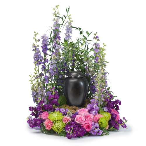 """This tribute combines a beautiful combination of pink and purple flowers that will show that your loved one will be forever cherished.  Approximately 20"""" W by 24"""" H"""