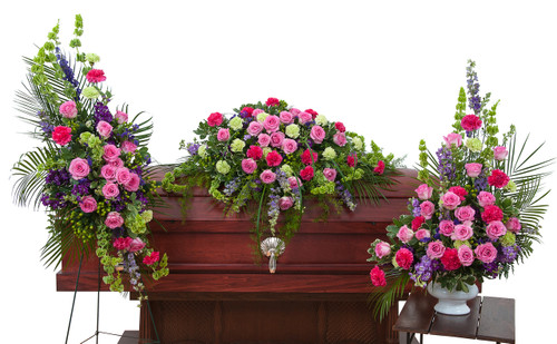 Forever Cherished Trio includes a casket spray, standing easel spray and crescent urn arrangement.