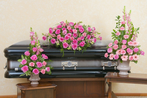Casket Spray and two urn designs in peaceful pink colors.