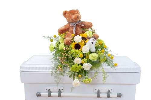 "This sweet combination of flowers and a stuffed bear is perfect for a tiny angel.  Approximately 18 "" (W) x 22""(H)"