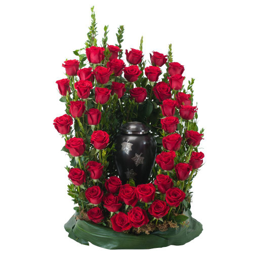 "Red roses and premium foliage combine to make this elegant tribute.   Approximately 18"" W by 24"" H"
