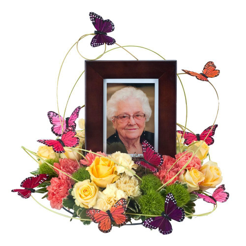 """Butterflies surround the photo of your loved one as a sign of hope and love. Approximately 16"""" in diameter"""