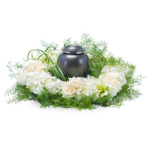 "White and cream blooms surround the urn of your loved one. Approximately 20"" (W) x 6""(H)"
