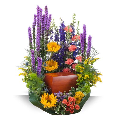 "These beautiful garden variety flowers surround the urn of your loved one.  Approximately 20"" wide by 24"" high"