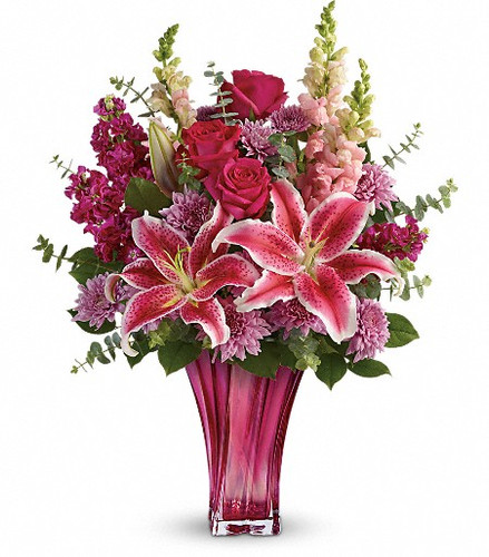 Pretty in pink! Elegantly crafted in blown glass, this vibrant fuchsia vase is the ultimate way to celebrate the best mom in the world - yours! It's artistically arranged with a truly decadent bouquet of hot pink roses, fragrant stargazer lilies and pink snapdragons - a Mother's Day gift she'll never forget! This elegant bouquet features hot pink roses, pink stargazer lilies, burgundy stock, lavender cushion spray chrysanthemums, pink snapdragons, spiral eucalyptus, and lemon leaf.