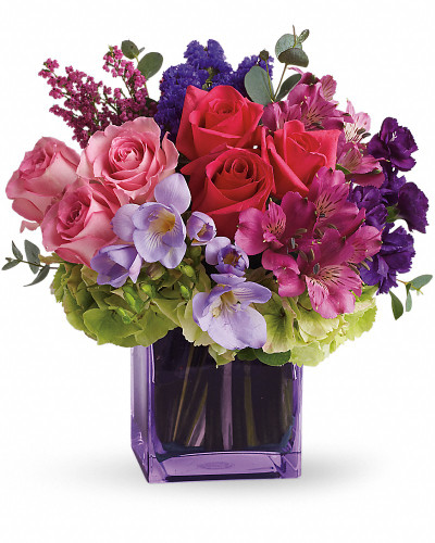 This exquisite mix of feminine blooms is like a breath of fresh air! Sweet pinks and purples are contrasted with a modern burst of fresh green hydrangea, and finished off with a pretty lavender cube vase lined with a tropical aspidistra leaf. It's a fun pick-me-up to send anytime, anywhere!  A wide variety of blooms such as - roses, alstroemeria, hydrangea, stock, freesia, statice and heather.