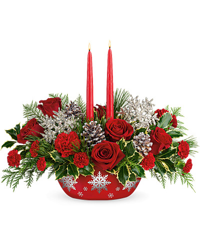 Make the winter's eve table shine with this festive candlelit centerpiece of radiant red roses and winter greens, artfully arranged inside a hand-glazed, oven-to-table ceramic serving dish that shimmers with swirling silver snowflakes!  Make the winter's eve table shine with this festive candlelit centerpiece of radiant red roses and winter greens, artfully arranged. Deluxe and Premium use more roses for a bigger splash.