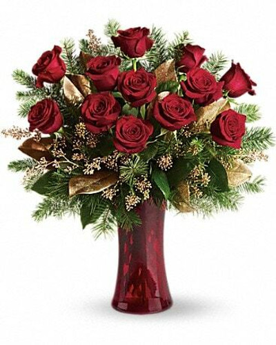 Dazzling and delightful. A dozen red roses make a dashing holiday gift, especially when they are arranged with brilliant holiday touches and delivered in a ruby red vase.
