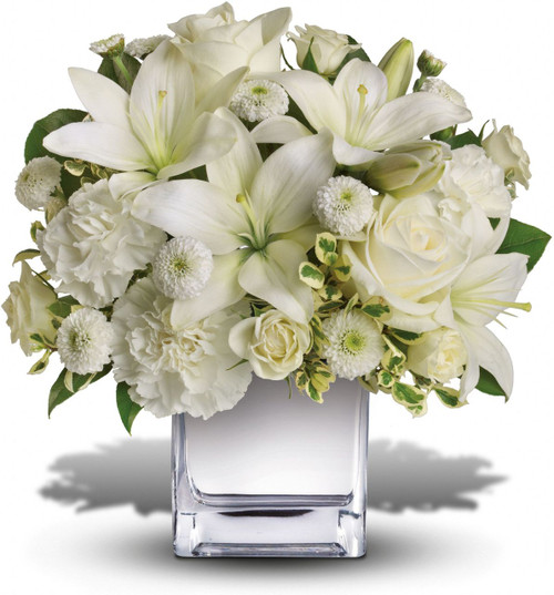 Perfect for Christmas or Hanukkah, this exquisite all-white bouquet in a dazzling mirrored silver cube may be petite, but it will make a huge impression. So much beauty for such a merrily modest price tag.