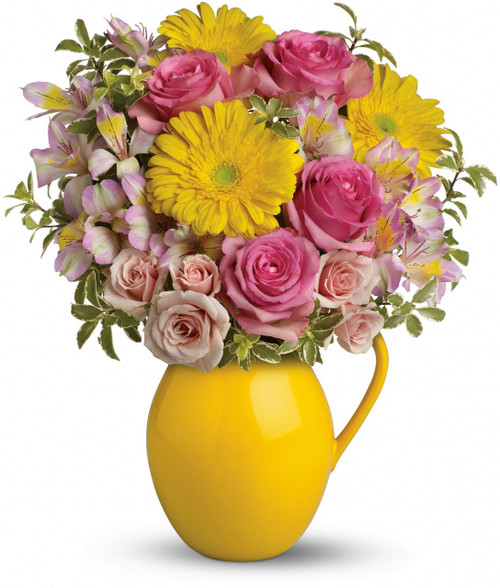 Fill their cup with happiness! This signature Sunny Day pitcher is sure to pour joy! Filled with beautifully bright gerberas and sweet roses, it's a gift they'll always treasure.