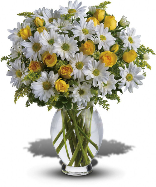 Celebrate the brightest of occasions with this cheerful bouquet of happy-faced daisies presented in a graceful, curved vase.