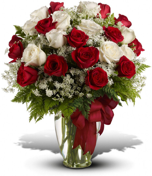 Love's divine, and roses are too. At almost two feet tall, this beautiful mix of red and white roses - accented with Queen Anne's Lace or Million Star Baby's Breath, and adorned with a bold red ribbon - is a timeless gift for your beloved.