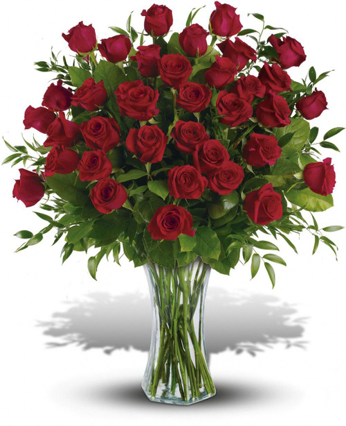 One, two, three! Three dozen spectacularly gorgeous red roses delivered in a dazzling flared glass vase - positive proof that love is a many-splendored thing. Imagine her loving this amazing bouquet day after day. Hero-worshipping time.