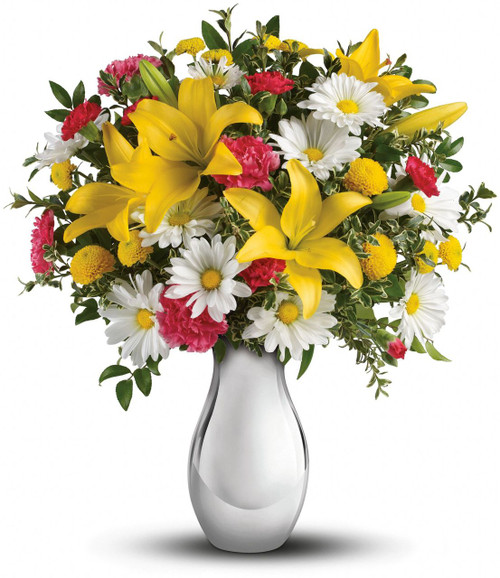Won't she be tickled? Sure to put a smile on her face, this happy bouquet greets her with sunny yellow lilies, hot pink carnations and crisp white daisies arranged garden style in a lovely vase.  Actual vase will vary.