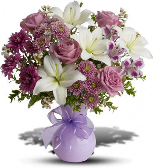 Do they have a flair for the dramatic? They'll applaud this stunning array of flowers in a chic lavender vase accented with a lavender ribbon. Expect a great review.
