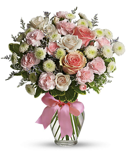 What a sweet way to celebrate the arrival of sugar and spice and everything nice! This pretty arrangement will delight any new mom or mom-to-be, that's for sure! Feminine flowers fill a charming ribbon-wrapped vase. It's a beautiful thing!