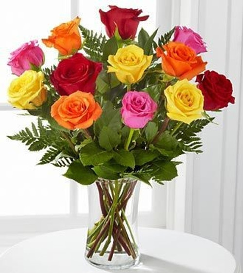 Surprise someone with a Rainbow of a Dozen Lovely Long Stem Roses!  Mixed colors compliment each other for a stunningly beautiful dozen rose bouquet.
