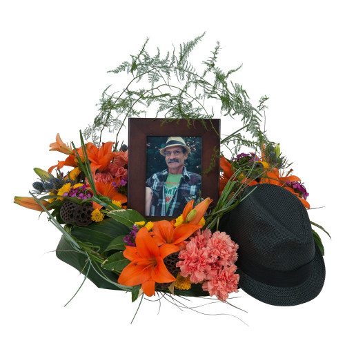 """Lilies and a variety of bright color blooms add to the personalization of a wildflower look.  Approximately 18"""" W by 12"""" H"""