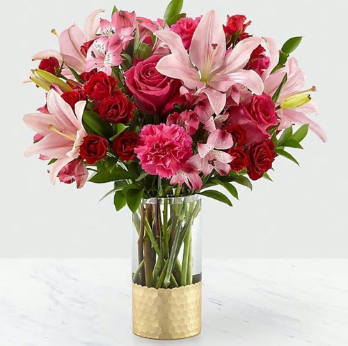 Treat your better half to an arrangement filled with blushing blooms and stunning texture. In our Be My Beloved™ Bouquet, you'll find it's overflowing with spray roses, carnations, alstroemeria and lots of love. With a classic Valentine's color palette of pink, hot pink and red, this arrangement is sure to make their day.