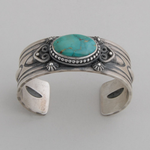 "Sterling silver cuff with traditional stamp, repousse and ""rope"" work.  Beautiful Royston Turquoise!"