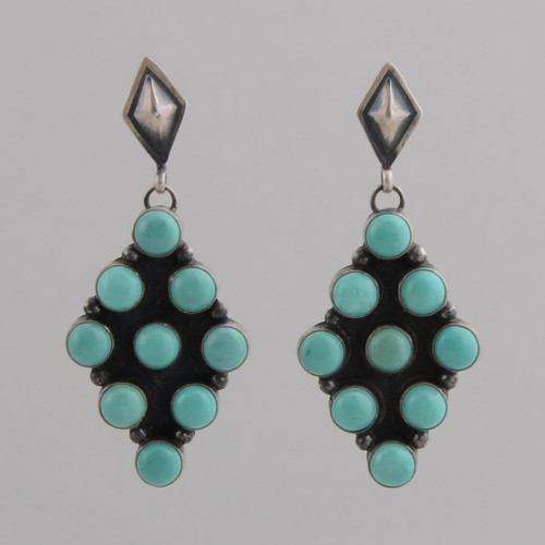 Sterling Silver Earrings with Green Turquoise Round Stones set in a Diamond Shape.  Repousse Top.  w/ Post.