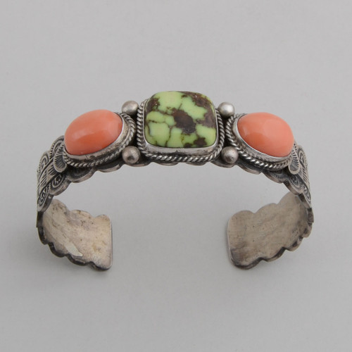 Sterling silver cuff with traditional stamp work and beautiful Demali Turquoise and Angel Skin Coral.
