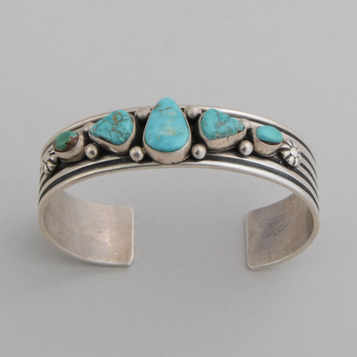 "Slender sterling silver cuff with Pilot Mountain Turquoise.  Very nice silver ""bubble"" work with the stones."