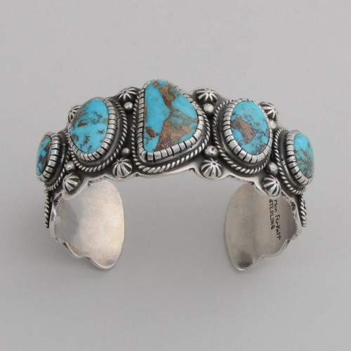 Sterling Silver Cuff w/ Fox Turquoise, Repousse Silver.