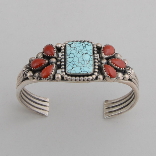Sterling silver cuff allows the #8 Spiderweb Turquoise and rich red coral to be showcased.
