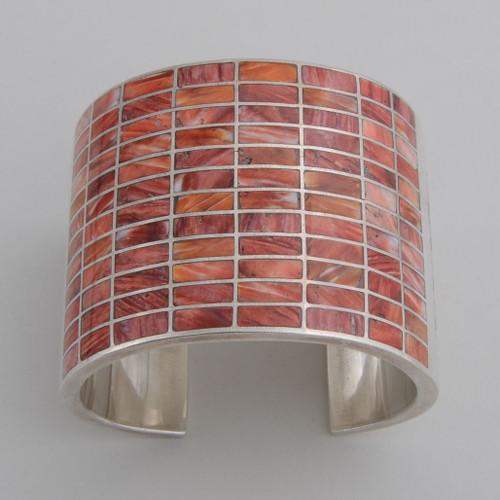 Sterling Silver Orange Spiny Inlaid Bracelet /w Design on Sides.