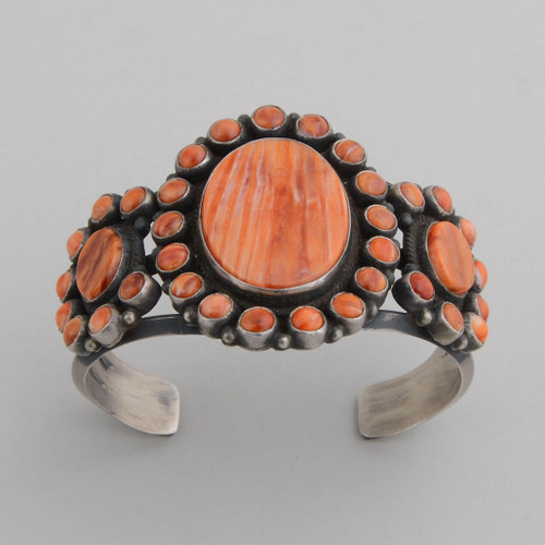 Sterling Silver Cuff w/ Orange Spiny Oyster Shell, 1 Large Stone w/ Multiple Small Stones.