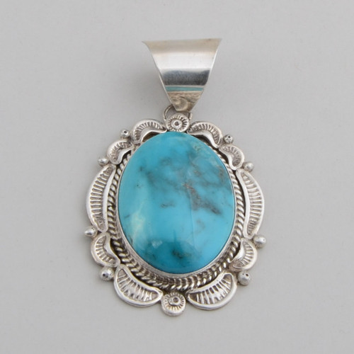 Sterling Silver Pendant with Dome Cut Turquoise.